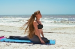 pigeon pose on beach